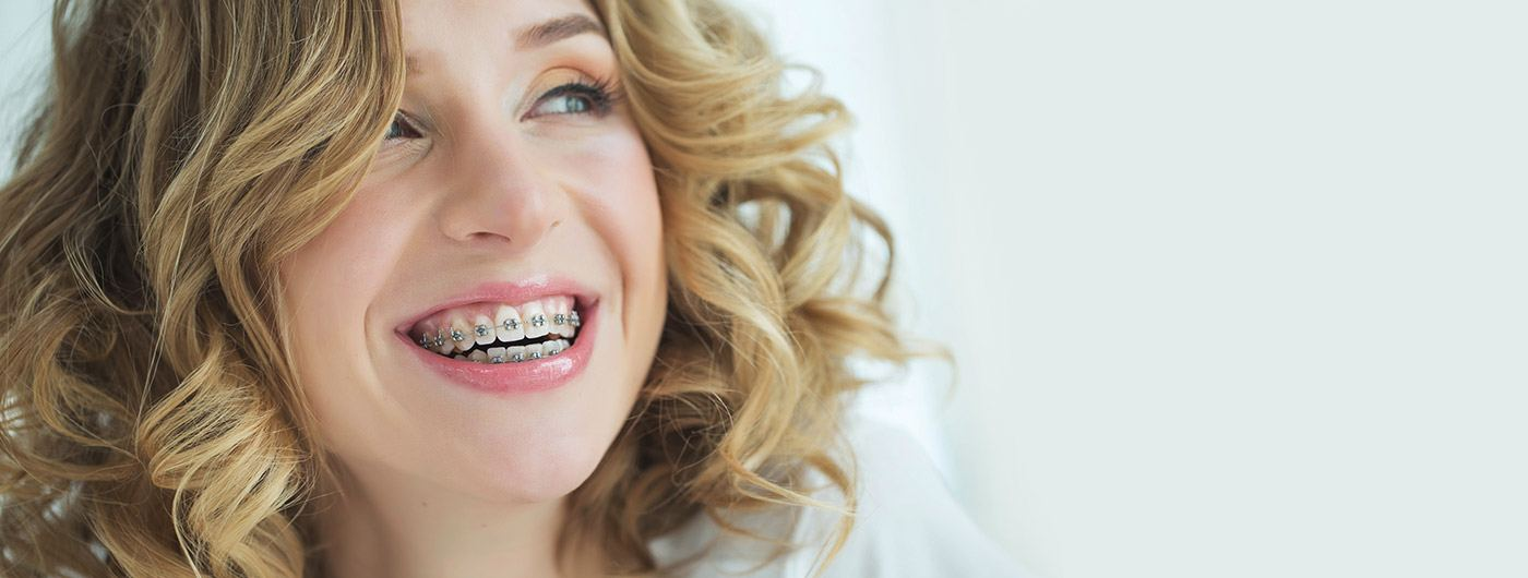 Smiling woman with traditional braces