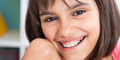 Preteen girl with orthodontic appliance