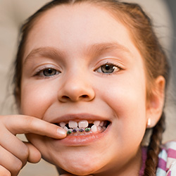 Young girl with orthodontic appliance